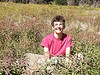 Photo of Kelley in Colorado meadow.