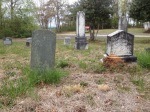 The headstone of James W. Hughes is on the left. His wife's headstone is on the right.