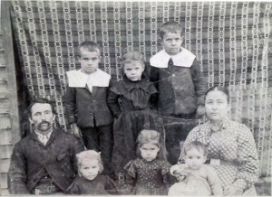 My father tells me this photo of James Harvey Hughes and family was taken about 1899.